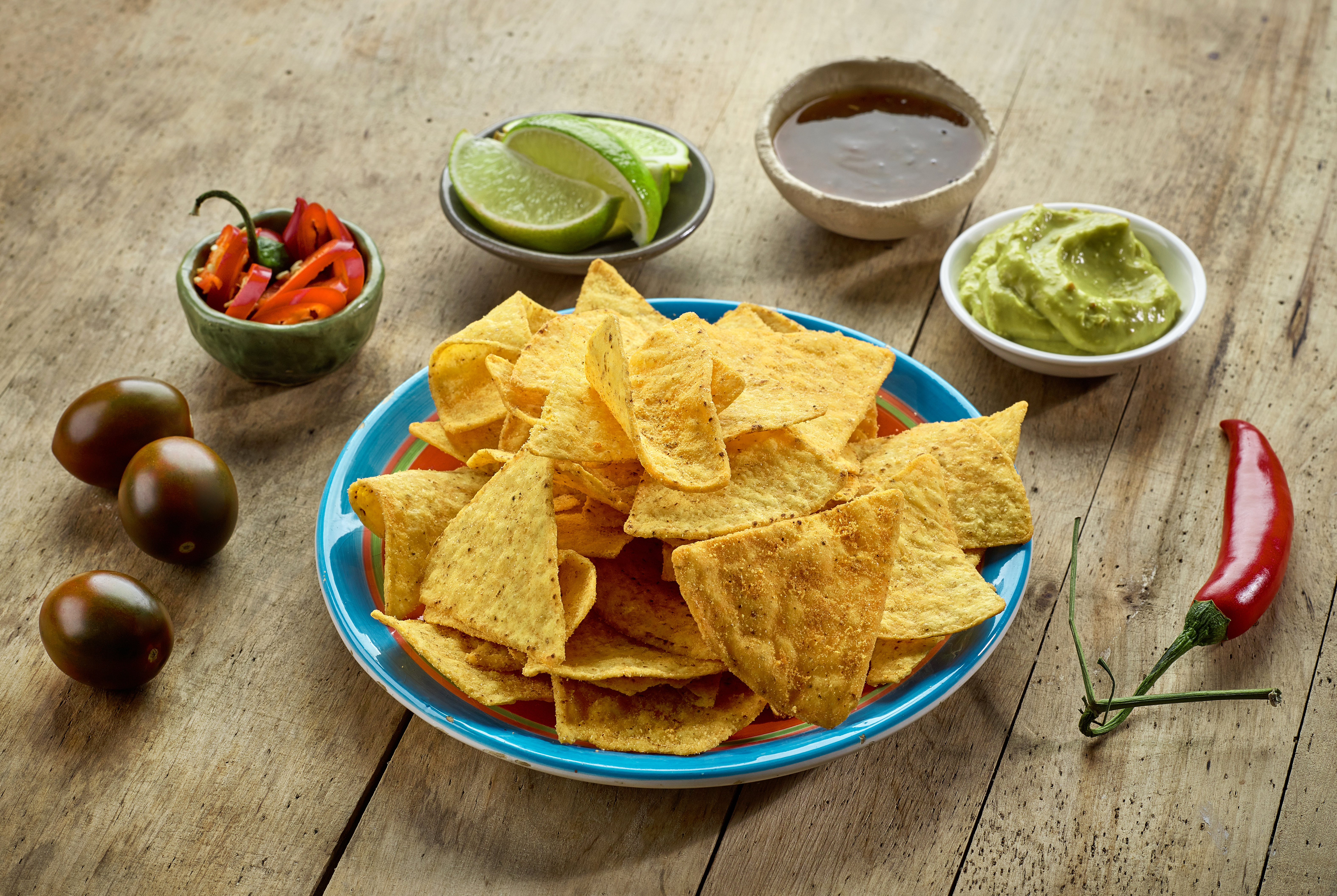 Mexican food Nachos chips on wooden table